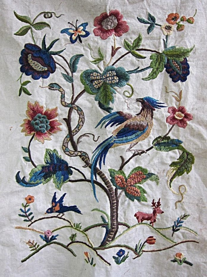 Beautiful embroidery depicting tree and birds and snakes