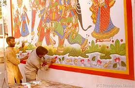 Phad painting being done on a wall