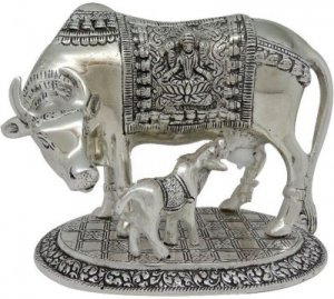 A cow and calf metal statue